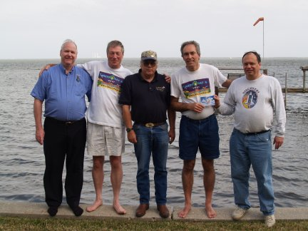 left to right, Bob McCullough (Big Rapids, Michigan), Richard Tonkin (Melbourne, Australia), Matt Nelson (Houston, Texas), Ron Caswell (Titusville, Florida), and Ken Harman (Vancouver, Canada) with Kennedy Space Center in background, January 2006