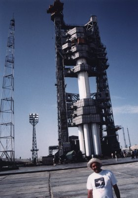 Ken Harman with Proton Rocket on pad in Baikonour